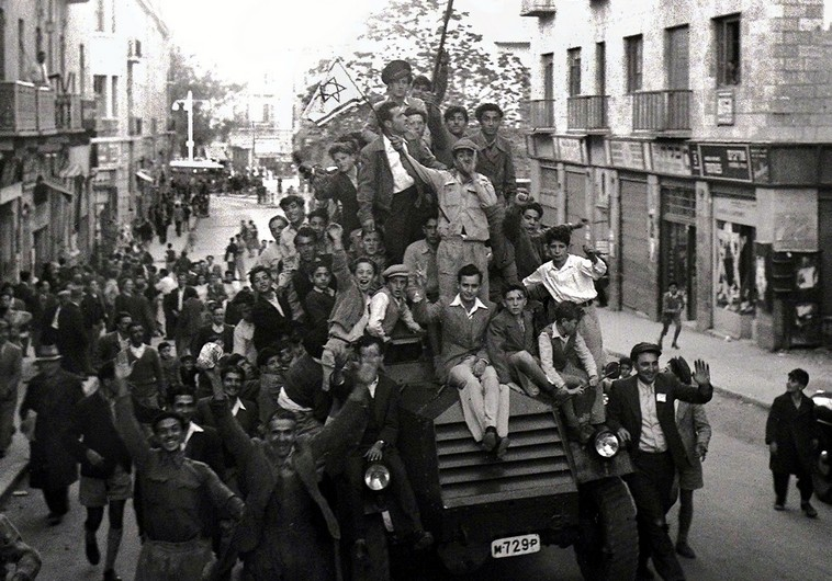 Jews crowd onto a British army armoured car as they celebrate in downtown Jerusalem the morning after the United Nations voted on November 29, 1947 to partition Palestine which paved the way for the creation of the State of Israel on May 15, 1948. . (photo credit:REUTERS)