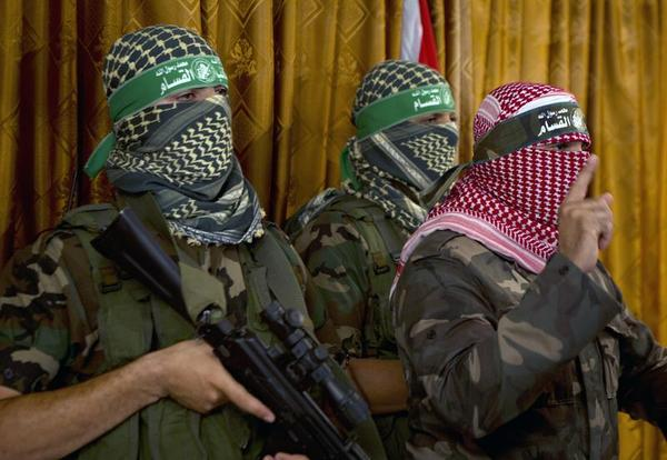 Abu Obeida (R), the official spokesperson of the Palestinian militant group Ezzedine al-Qassam brigade, the armed wing of Hamas, give a press conference on July 3, 2014 in Gaza City. Islamist Hamas movement, whom Israel has blamed for the kidnap and murder of the three teenagers in June, said it held Netanyahu's government directly responsible for the killing of Abu Khder. 'You will pay the price for your crimes,' it said. AFP PHOTO / MOHAMMED ABED MOHAMMED ABED/AFP/Getty Images