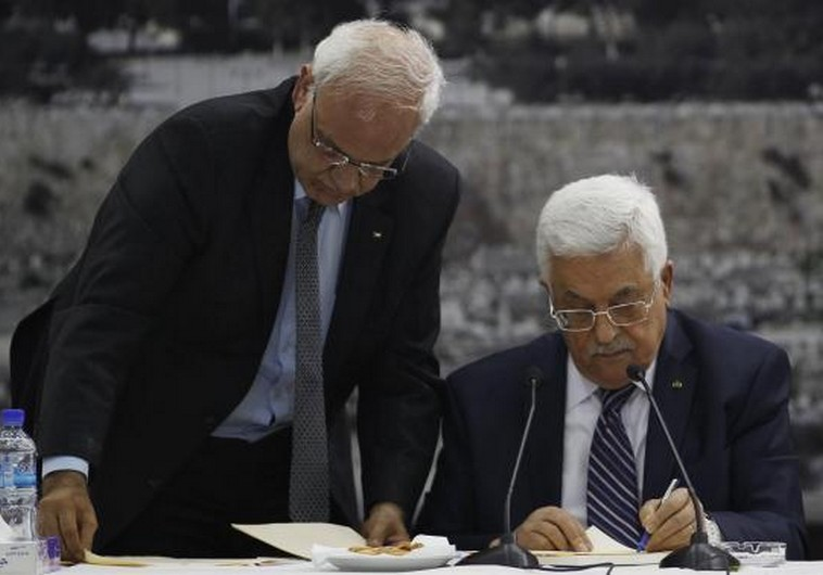 Palestinian Authority President Mahmoud Abbas (R) and his chief peace negotiator, Saeb Erekat, in Ramallah. (photo credit:REUTERS)