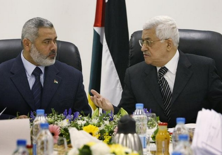 Palestinian Authority President Mahmoud Abbas (R) talks with Hamas leader Ismail Haniyeh.. (photo credit:REUTERS)