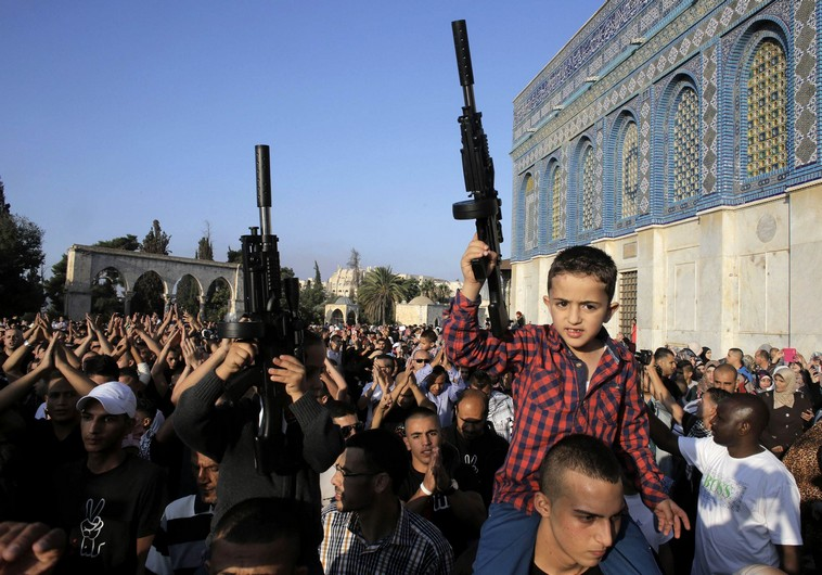 Palestinian children hold toy guns during a protest on the compound known to Muslims as al-Haram al-Sharif and to Jews as Temple Mount in Jerusalem's Old City,