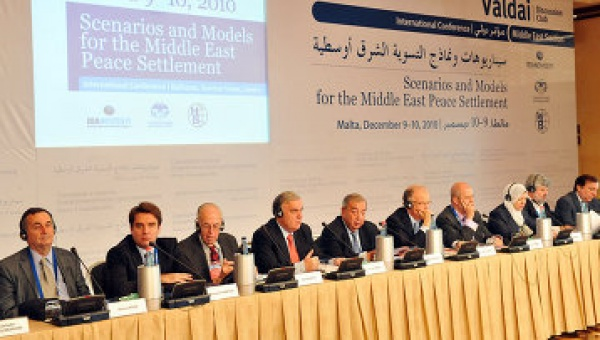 "Gershon Baskin (second from right) on the podium with world leaders at the interational summit ""Scenarios and Models of the Middle East Peace Settlement"", in La Valletta, Malta, on Dec. 9, 2010."