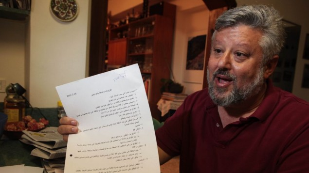 Gershon Baskin holds the draft agreement between Israel and Hamas for the release of Gilad Shalit at his home in Jerusalem, October 12, 2011 (photo credit: Kobi Gideon/Flash90)