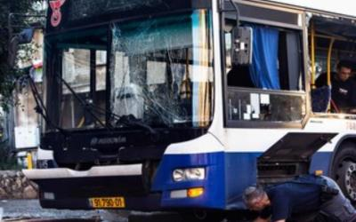 Police bomb experts at the scene of the attempt terrorist attack in Bat Yam, December 22, 2013. Bat Yam bus bombing 370. (photo credit:REUTERS/Nir Elias)