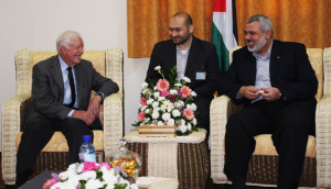 The head of Hamas goverment in the Gaza Strip, Ismail Haniyeh (R), sits with former U.S. President Jimmy Carter in Gaza City, the Gaza Strip. Carter is in the Gaza strip.