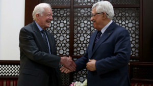 Palestinian Authority President Mahmud Abbas shakes hands with former US president Jimmy Carter