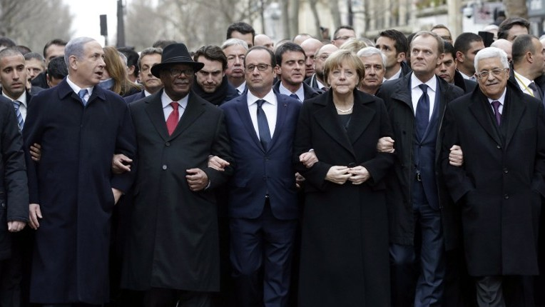 French President Francois Hollande (3rd from left) is surrounded by heads of state (from left to right) Prime Minister Benjamin Netanyahu, Ibrahim Boubakar Keita of Mali, Chancellor Angela Merkel of Germany, EU Council President Donald Tusk and Palestinian Authority President Mahmoud Abbas as they attend the solidarity march (March Republicaine) in the streets of Paris, January 11, 2015. (photo credit: AFP/Philippe Wojazer, Pool)