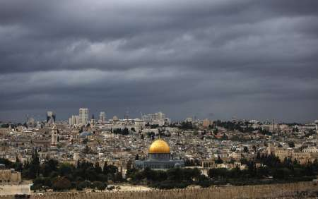 Rain clouds are seen over the Dome of the Rock, on the compound known to Muslims as al-Haram al-Sharif, and to Jews as Temple Mount, in Jerusalem's Old City October 30, 2009. REUTERS/Darren Whiteside