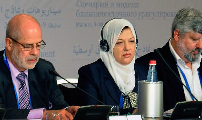 "Palestinian MP Sahar Qawasmi, center, is flanked by Vitaly Naumkin, director of the Center for Arab Studies at the Institute of Oriental Studies, Russian Academy of Sciences, at left, and Gershon Baskin, Israeli Co-Director and founder of the Israel/Palestine Center for Research and Information International conference, at right, as they attend the first day of the international summit ""Scenarios and Models of the Middle East Peace Settlement"", in La Valletta, Malta, Thursday, Dec. 9, 2010. (AP Photo/Lino Arrigo Azzopardi)"