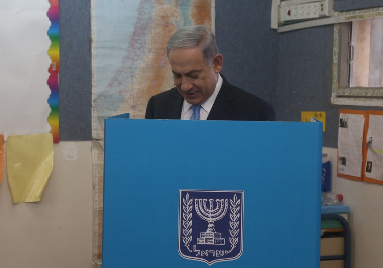 Prime Minister Benjamin Netanyahu votes in national election, March 17, 2015. (photo credit:MARC ISRAEL SELLEM)