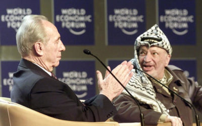 "Shimon Peres, Minister of Regional Cooperation of Israel, left, applauds Palestinian leader Yasser Arafat, right, as it is announced that Arafat is about to speak at the Davos World Economic Forum. Both took part in the forum on ""From Peacemaking to Peacebuilding."" Peres, a former Israeli president and prime minister, whose life story mirrored that of the Jewish state and who was celebrated around the world as a Nobel prize-winning visionary who pushed his country toward peace. (AP Photo/Herbert Knosowski)"