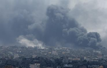Smoke rises during what witnesses said were heavy Israeli shelling at the Shejaia neighbourhood in Gaza City Photo: REUTERS